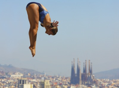 Trampolining in the Picornell pools with the city in the background. (© Lluís Carro)